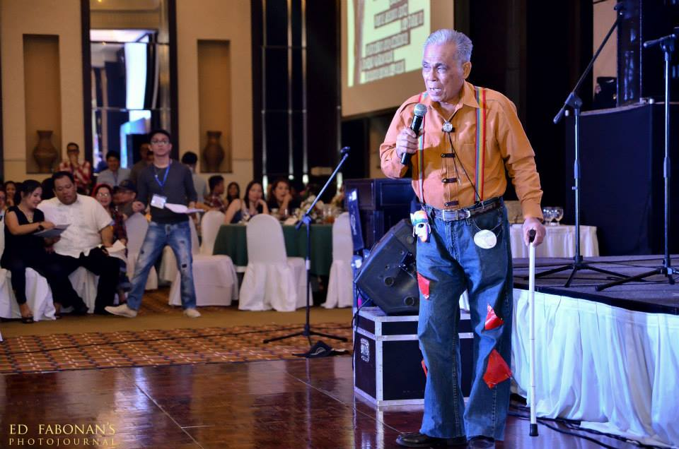 "This is Toastmaster Greg competing the ""Groovy Lolo"" contest during the Toastmasters Fellowship Night. (Photo courtesy of Ed Fabonan)"